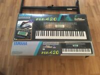 Professional Yamaha keyboard complete with stand and original box-ideal as gift immaculate condition