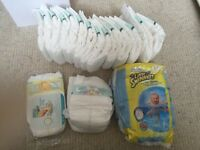 Free - handful of newborn nappies and a few size 2-3 swim nappies