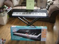 Casio LK-160 Light Up Key Keyboard great Condition Boxed with stand, music book