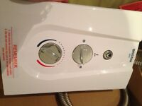 Electric shower. 3 months old. Removal of invalid shower Hardly used. £35