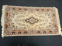 A Persian style rug, the central foliate medallion on a sage green ground, 140x75cm