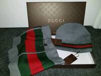 Grey Gucci hat and scarf set.