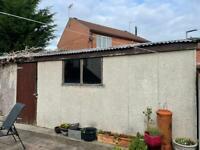 Concrete panel garage