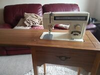 Toyota Sewing Machine in fold-away table