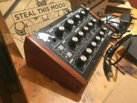 Moog Minitaur Bass synth. Perfect condition, all complete, with extra wooden sides.
