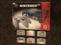 Nintendo 64 boxed console and games. N64