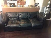 Comfy and stylish black leather couch - perfect for condos!