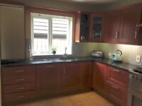 Fitted cherry wood kitchen with granite worktops for sale