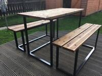 Brand new table and two benches to suit .