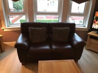 2x brown leather 2 seated sofa