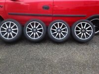 "15"" wolf race alloys with tyres"