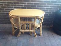 Rattan compact dining table with 2 chairs