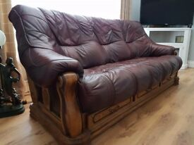 2 identical leather sofas 1 in perfect condition the other has 2 small tears