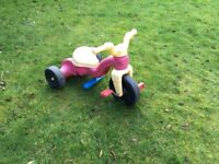 Toddlers plastic trike with moveable pedals