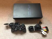 Ps2 console with controller and cables