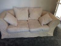 Cream 2 seater material sofa