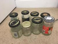 Eight glass jars and bottles