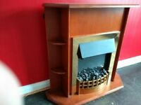 Wooden fire surround with fitted electric fire