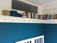 Wooden shelves with pegs