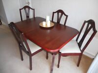 Dining room table, chairs and sideboard