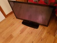 """LG 42"""" black with glass stand"""