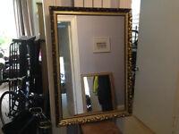 Nice Gold coloured framed mirror