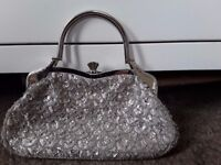 Beautiful silver evening bag with clasp closure detail is exceptional inc faux diamonds
