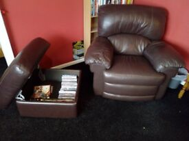 brown leather armchair and storage pouffe