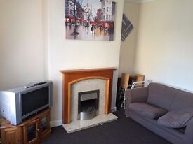 Clean shared house with large garden and private parking near Armley Town street and easy to City.
