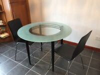 Glass Table and 2 chairs. Great for a small space