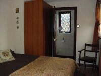 Furnished room with separate shower and toilet