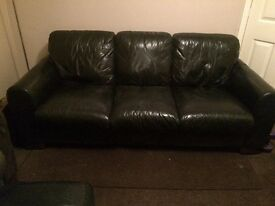 Black leather three seater sofa