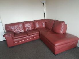 3 corner red leather suite in good condition only selling as upgrading