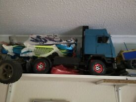 REPAIR, TUNE, MAINTAIN, RESTORE, R/C CARS. TRUCKS, TANKS & BOATS