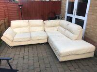 Cream leather corner sofa with silver legs