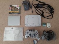 PS One with two controllers, 2 memory cards, 2 demo discs and 4 full games