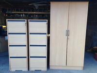 Two 4 drawer beech filing cabinets and a 4 shelf filing cupboard