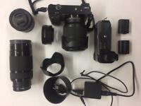 Sony a6000 digital camera + 3 lenses + lens adapter + battery grip