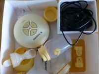 Medela swing electric breast pump + starter kit