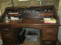Roll Top Desk in dark wood.