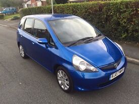HONDA JAZZ , IT HAS HAD LIGHT REAR END DAMAGE, NOW COMPLETLEY REPAIRED WITH 12 MONTHS MOT.