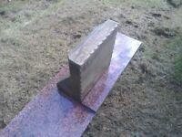 Small sandstone headstone / memorial, and granite plinth.