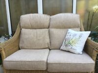 Cushioned upholstered seats, backs and footstool for conservatory furniture