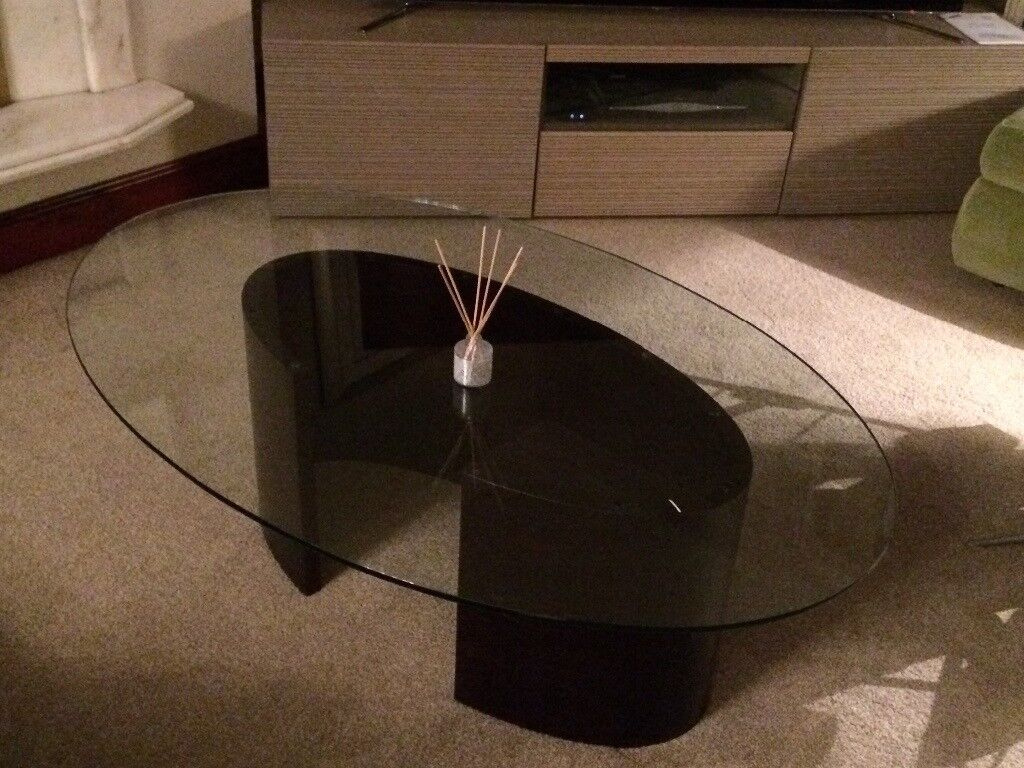 Oval shaped glass top coffee table