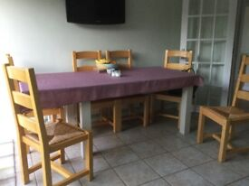 Extendable pine kitchen table and 6 chairs seats up to 10