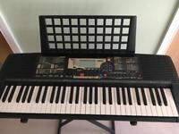 Yamaha PSR 225 electric keyboard and stand