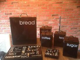 Black kitchen storage canister set / pack. Tea, coffee, sugar, placemat, coasters, mug tree, bread