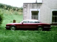 1994 Jaguar Sovereign in need of a little fixing up or restoration.