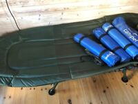 Two deluxe folding camp beds
