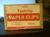 A partially used box of 1000 small Fastclip metal paper clips in exellent condition. White metal.